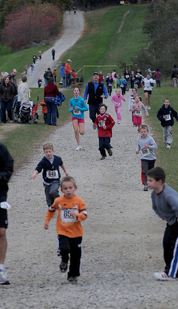 Amesbury: Runners sprint to the finish in the 1 mile run at the Cider Hill Mash road race at the Cider Hill Farm in Amesbury Sunday. Jim Vaiknoras/Staff photo/Staff photo