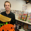 newburyport: Pete Herman of from Express Video pulls a  golden tickets, enititling the bearer to special treats at Steve Crosby's halloween fun house on Marlboro st. Jim Vaiknoras/Staff photo