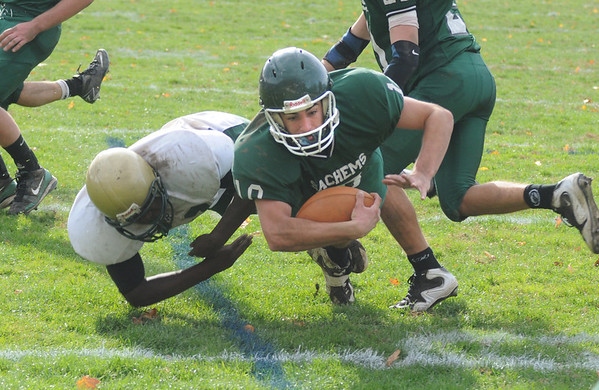 West Newbury: Pentucket's Mike Doud dives across the goal line for a 2 point conversion against North Reading in West Newbury Saturday. Jim Vaiknoras/Staff photo