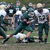 West Newbury: Pentucket's Paul Treado cut through the line for a big gain against North Reading in West Newbury Saturday. Jim Vaiknoras/Staff photo