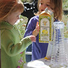 NEWBURYPORT: Olivia Fisher and Sadie Reardon enjoy some lemonaide at the Newburyport Mothers Club Bake-off at the Bellville Church in Newburyport Saturday. Jim Vaiknoras/Staff photo