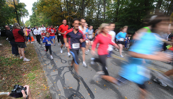 West Newbury: Runner take off at the start of the Apple Harvest Road Race in West Newbury Sunday afternoon. Jim Vaiknoras/Staff photo
