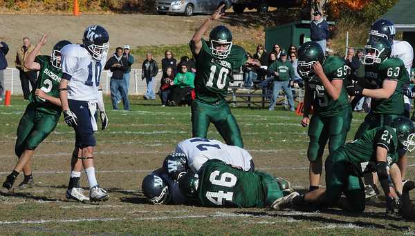 West Newbury: Pentucket player celebrate recovering a Wilmington fumble during their game in West Newbury Saturday. Jim Vaiknoras/Staff photo