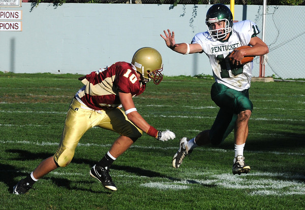 Newburyport: Pentucket's Mike Doud stiff arms Newburyport's Brett Fontaine during their game at Newburyport Saturday afternoon. Jim Vaiknoras/Staff photo