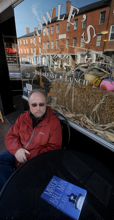 "Newburyport: Author Joel Brown with his book ""Mirror Ball Man"" at Fowles on State Street in Newburyport. Jim Vaiknoras/Staff photo"
