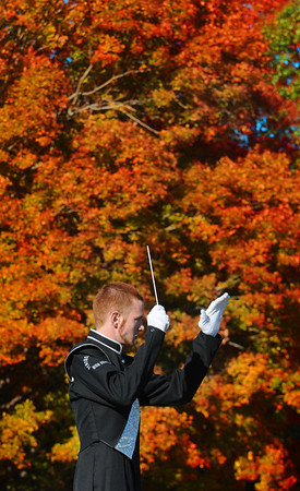 Wesyt Newbury; Pentucket high drum major Yuri Arsenault of Merrimac conducts the marching band at the Sachems home game against Wilmington Saturday. The band performed on the field at half-time for the first time since 1999. Jim Vaiknoras/Staff photo