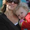 NEWBURYPORT: Annie Jacobsen of Newburyport enjoys a cup cake and a hug with her mom Erica at the Newburyport Mothers Club Bake-off at the Bellville Church in Newburyport Saturday. Jim Vaiknoras/Staff photo