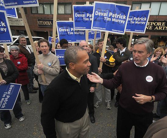 Newburyport: Governor Deval Patrick talks with Congressman John Tierny at a rally on Merrimack Street in Newburyport Saturday night. Jim Vaiknoras/Staff photo