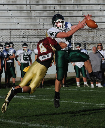 Newburyport: Pentucket's Tim Freiermoth can't bring down a pass as he is hit by Newburyport's Jonathan Wright during their game at Newburyport Saturday afternoon. Jim Vaiknoras/Staff photo