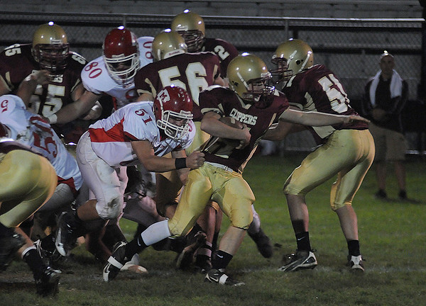 Newburyport:Newburyport's Tyler Cusack breaks a tackle against Masco at War Memorial Stadium in Newburyport Friday night. Jim Vaiknoras/Staff photo