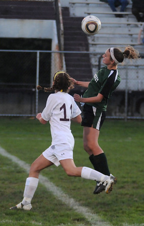 Newburyport: Pentucket's Haley DesRosiers goes up for a header while defended by Newburyport's Carly Brand during the ALS Cup game at War Memorial Stadium in Newburypprt Thursday night. Jim Vaiknoras?staff photo