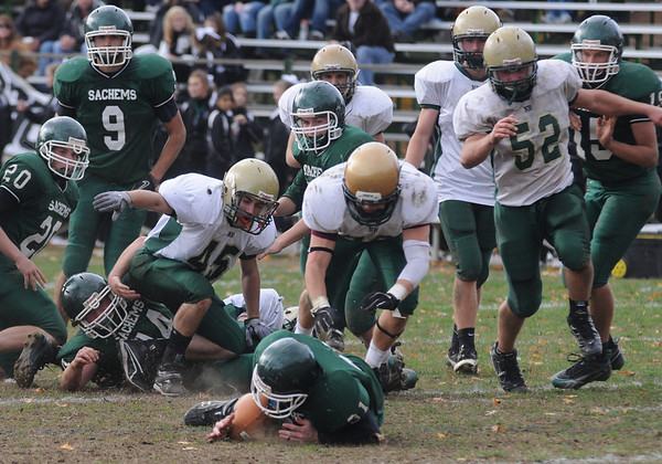 West Newbury: Pentucket's Chris Croteau recovers a fumble against North Reading in West Newbury Saturday. Jim Vaiknoras/Staff photo