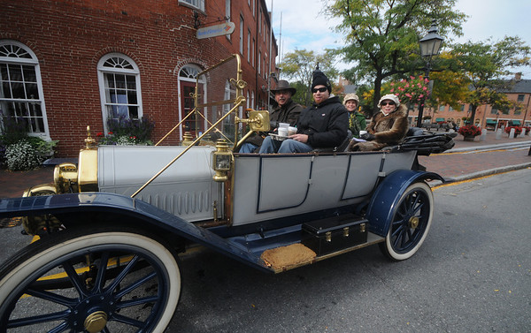 Newburyport: The Trippi family , Tony, driving next to sone Frank with his wife Janet and daughter in law Kerry in the back seat drove their 1912 Moline Dreadnought to Marker Square in Newburyport for coffee Sunday. The family were participating in a parade of antique car through the area. JIm Vaiknoras/Staff photo