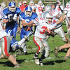 Georgetown: Amesbury's Stephan Deas gains yardage at Georgetown Saturday. JIm Vaiknoras/Staff photo