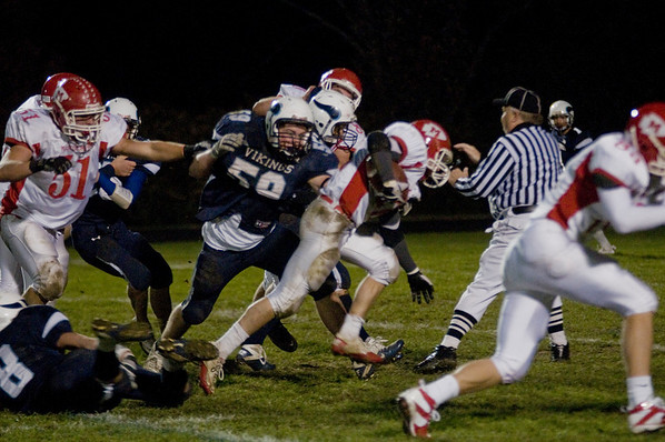 Byfield: Triton's linebacker Ryan Clay fights off a block to tackle Masco back Dylan Mann during their game at Triton Friday night. JIm Vaiknoras/Staff photo