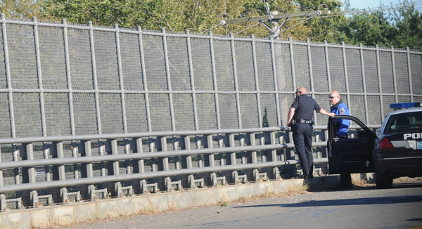 Newbury: Police involved in Fridays manhunt watch rt 95 from the Center Street overpass. Jim Vaiknoras/Staff photo