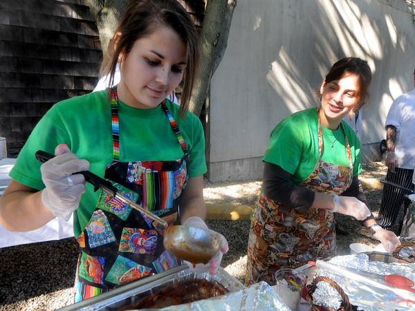 Newburyport: Kendall Grasso and Kim Genew of the Green Bean Deli serve their vegetarian chili at the 3rd annual Chili Festival at the Grog in Newburyport Saturday. Jim Vaiknoras/Staff photo