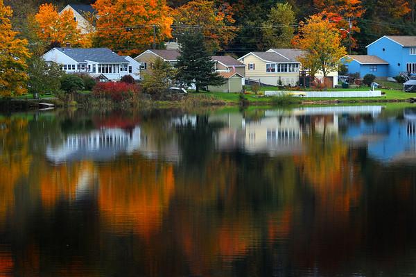 Amesbury: Foliage reflected off Lake Gardner in Amesbury. Jim Vaiknoras/Staff photo