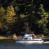 Amesbury: A boats motors down the Newburyport side of the  Merrimack River in the fading afternoon light as seen from Salisbury Point in Amesbury. Jim Vaiknoras/Staff photo