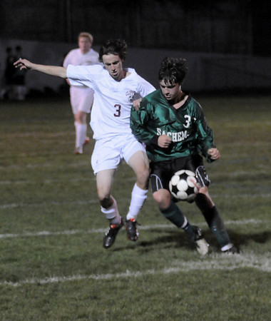 Newburyport: Newburyport's  Kyle Gershuny  and Pentucket's David McCarron fight for the ball during the ALS Cup game at War Memorial Stadium in Newburyport Thursday night. Jim Vaiknoras/staff photo