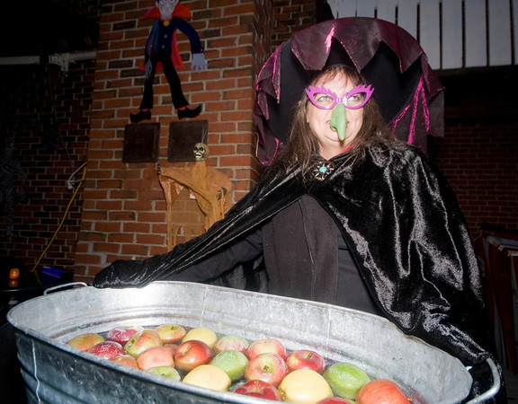 """newburyport: Martha Micheals get ready to bob for apples at Abraham's Bagels at """"Witches Night Out"""" Friday night in Newburyport. Jim Vaiknoras/Staff photo"""