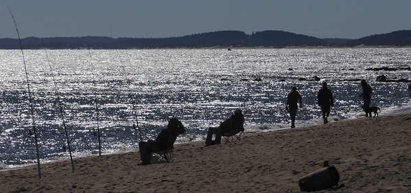 Newbury: Fishermen and walkers brave a cold October morning Sunday to enjoy the beach on Plum Island/ Jim Vaiknoras/Staff photo
