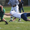 West Newbury: Pentucket's Dab Cashman breaks a tackle during the Sachem's game against  Wilmington in West Newbury Saturday. Jim Vaiknoras/Staff photo