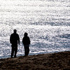 Newbury: Perry Davis and his son Marty take an early morning walk on Plum Island Saturday. Jim Vaiknoras/Staff photo