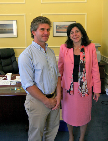 Newburyport: Newburyport resident Davis Lee meets with Mayor Donna Holladay Monday morning in her office at City Hall. Lee plans on swimming the English Channel later this week. Photo by Ben Laing/Staff Photo