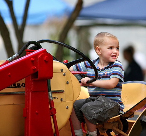 Newbury: Carson Meloon, 3, of Newton, NH sits atop a tractor at the Spencer Pierce-Little Farm in Newbury Saturday afternoon during their Fall Harvest Festival. Photo by Ben Laing/Staff Photo