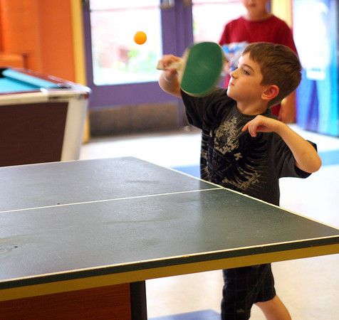 Salisbury: Gavin Hawkins, 6, sends a serve to his partner while playing ping pong at the Salisbury Boys and Girls Club Wednesday afternoon. Photo by Ben Laing/Staff Photo