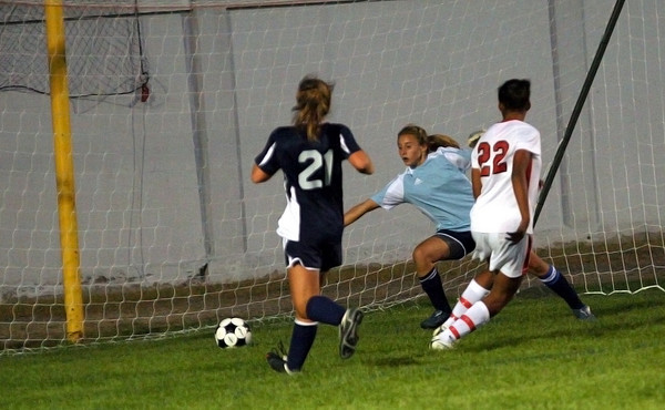 Amesbury: Amesbury's Whitney Whitlow (22) beats Triton goal keeper Jenna Norton for a goal early in the first half of Wednesday night's game at Landry Stadium. Photo by Ben Laing/Staff Photo