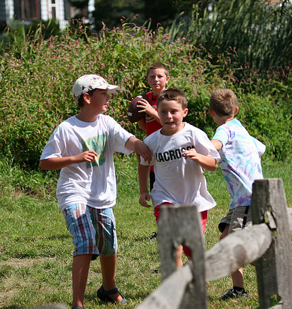 Newburyport: Boys at the River Valley Charter School play touch football at recess Thursday afternoon. Photo by Ben Laing/Staff Photo