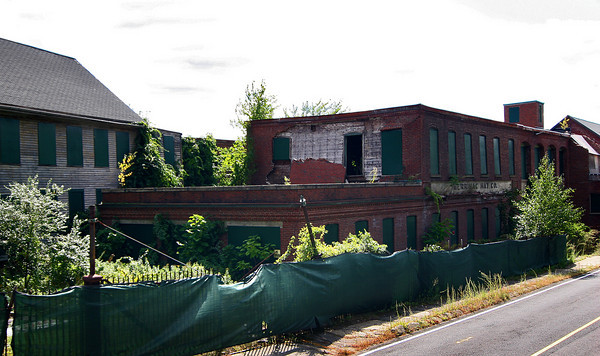 Amesbury: The Merrimac Hat Co. building in Amesbury was originally planned for renovation into condominiums. With half the building completed, the remaining half is now scheduled for demolishon. Photo by Ben Laing/STaff Photo