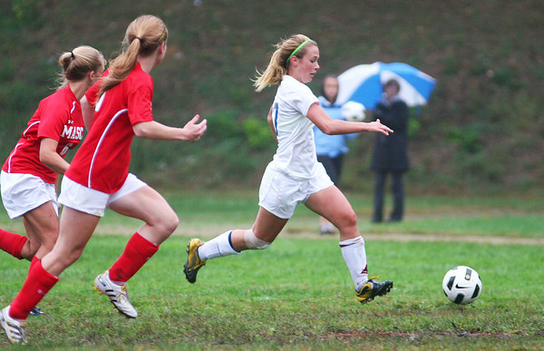 Georgetown: Nikki Holland (17) of Georgetown streaks past two Masconomet defenders during Monday afternoon's game. Photo by Ben Laing/Staff Photo