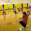 Newbury: Matson Knowles, front, prepares to throw her ball while the rest of her second grade classmates play monkeyball during gym class at Newbury Elementary School on Monday. Photo by Ben Laing/Staff Photo