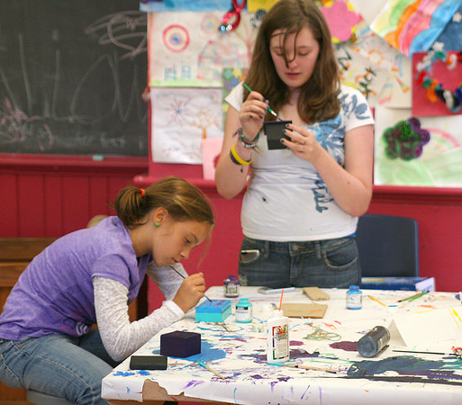 Newburyport: Michelle Thibault, left, and Anna Moore, both 12, work on their art projects at the drop-in center at the Kelley School in Newburyport. Photo by Ben Laing/Staff Photo