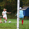 Georgetown: Georgetown's Nikki Holland (17) steps around a fallen Masconomet defender on her way to the goal during Monday afternoon's game. Photo by Ben Laing/Staff Photo