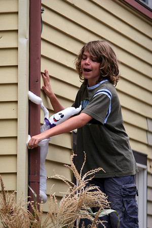 Amesbury: Jake Russell, 11, of Amesbury, helps his family set up their Halloween decorations Sunday morning. Photo by Ben Laing/Staff Photo