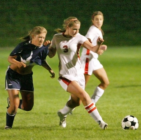 Amesbury: Amesbury's Maria Lufkin (3) fends off a Triton defender during Wednesday night's game at Landry Stadium. Photo by Ben Laing/Staff Photo