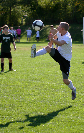 West Newbury: Pentucket's Josh Croteau reels in a long pass during soccer practice at Pipestave Hill in West Newbury Monday afternoon. Photo by Ben Laing/Staff Photo