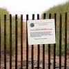 Newbury: Signs posted at various beach access points on Plum Island alert beachgoers that, due to the erosion, those sections of beach are closed to the public. Photo by Ben Laing/Staff Photo