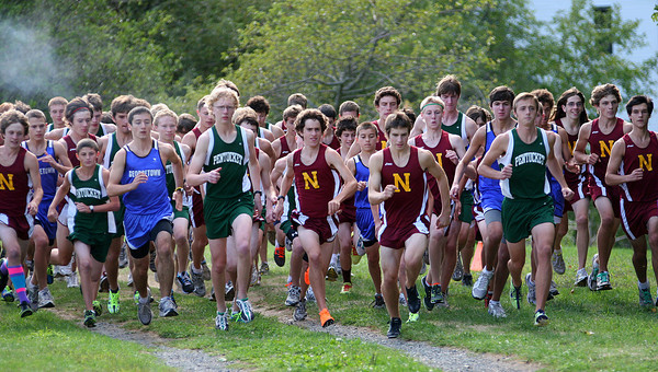 Newburyport: Runners from Newburyport, Pentucket and Georgetown take off from the starting line during Wednesday's cross country race at Maudslay State Park. Photo by Ben Laing/Staff Photo
