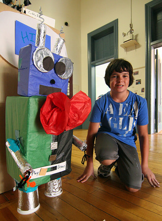 Newburyport: Ty Naughton, 13, of Newburyport, shows off his creation, the Cubby Bot, at the drop-in center at the Kelley School Wednesday afternoon. Photo by Ben Laing/Staff Photo