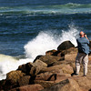 Newbury: A visitor to Plum Island Monday afternoon tries to snap a photo of the high surf kicked up by Hurricane Igor. Photo by Ben Laing/Staff Photo