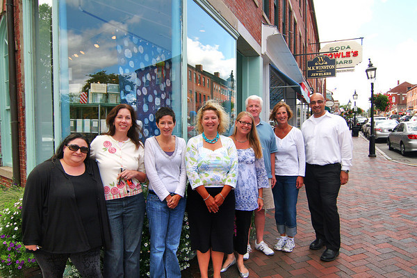Newburyport: Members of local downtown shops that will be participating in a scavanger hunt fundraiser, from left, Rebecca Pearson of Valentines, Valerie Stainton of Valerie's Galleries, Dianne Sirard of Soak, co-chairs of the fundraiser Belen Wieler-Hawes and Margie Frew, Steve DesLauries of the Book Rack, Dana Marshall of Loretta's and Matt Khatib of M.K. Winston Jewelers. Photo by Ben Laing/Staff Photo