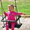 Amesbury: Pheobe Li, 1, of Newburyport, enjoys the swings at Amesbury Town Park Monday afternoon while visiting with her grandmother. Photo by Ben Laing/Staff Photo
