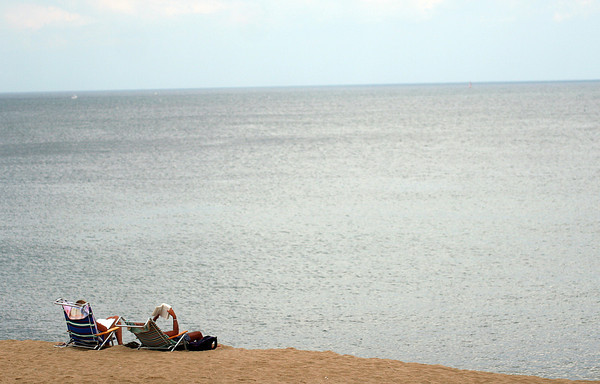 Newbury: A few hopeful beach goers wouldn't let go of the summer Wednesday afternoon, as they took an oppurtunity to enjoy Plum Island. Photo by Ben Laing/Staff Photo