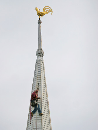 Newbury: A steeplejack scales the First Parish Church in Newbury Thursday morning. Photo by Ben Laing/Staff Photo