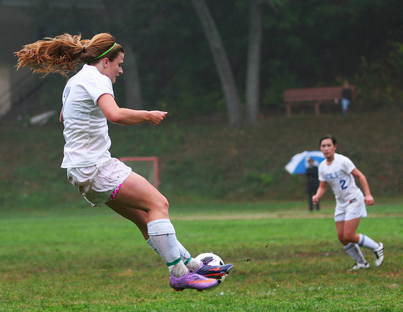 Georgetown: Coley DiMaio (7) of Georgetown leaves her feet for a ball during Monday afternoon's game against Masconomet. Photo by Ben Laing/Staff Photo